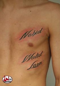 wink-tattoo-blackgrey-script-brust